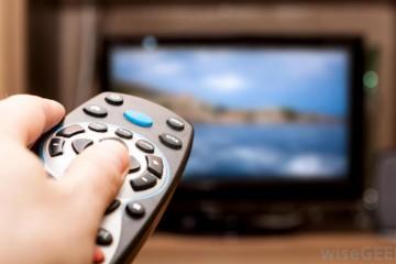 clicking-remote-at-television