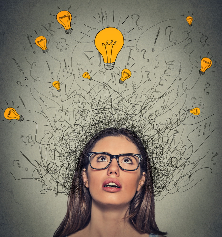 Closeup thinking woman with question signs and light idea bulb above head looking up on gray wall background