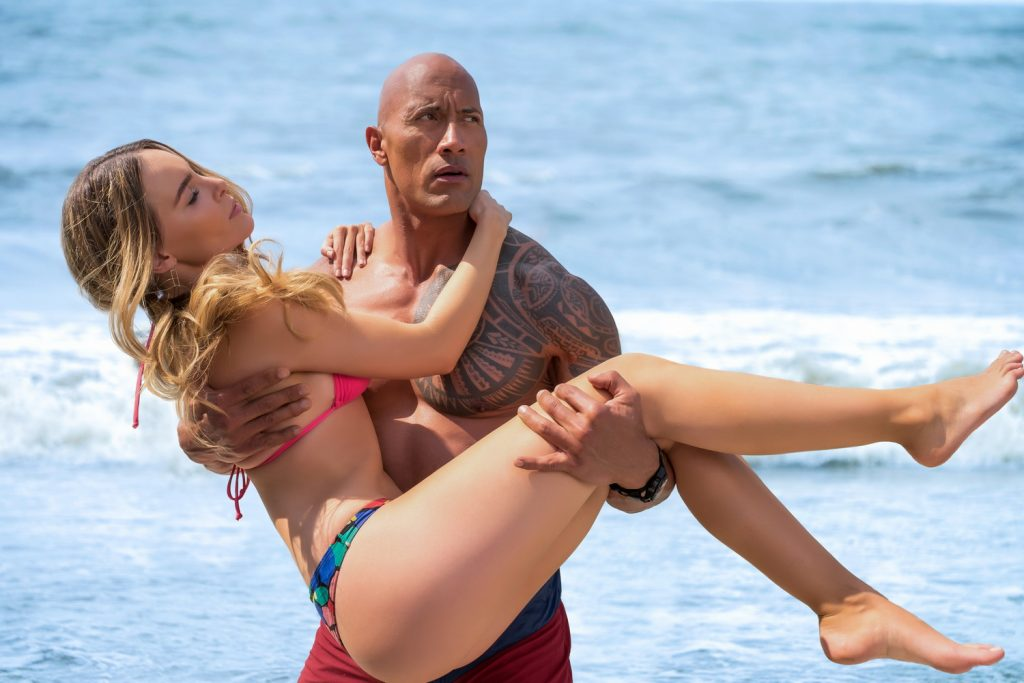 Belinda as Carmen and Dwayne Johnson as Mitch Buchannon in the film BAYWATCH by Paramount Pictures, Montecito Picture Company, FlynnPicture Co., and Fremantle Productions