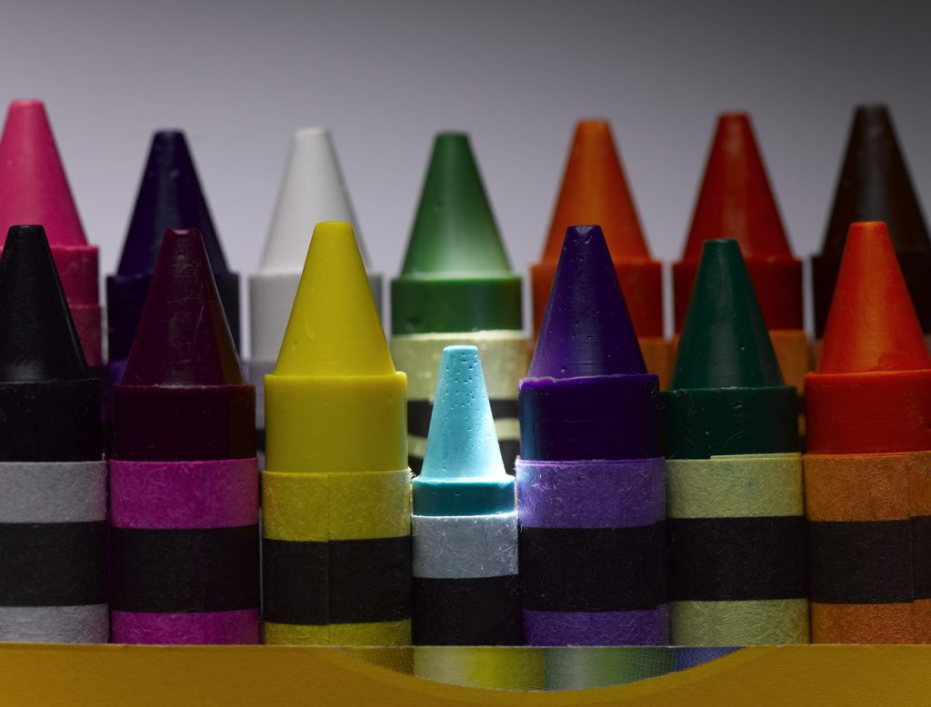 Rows of colourful crayons, close-up