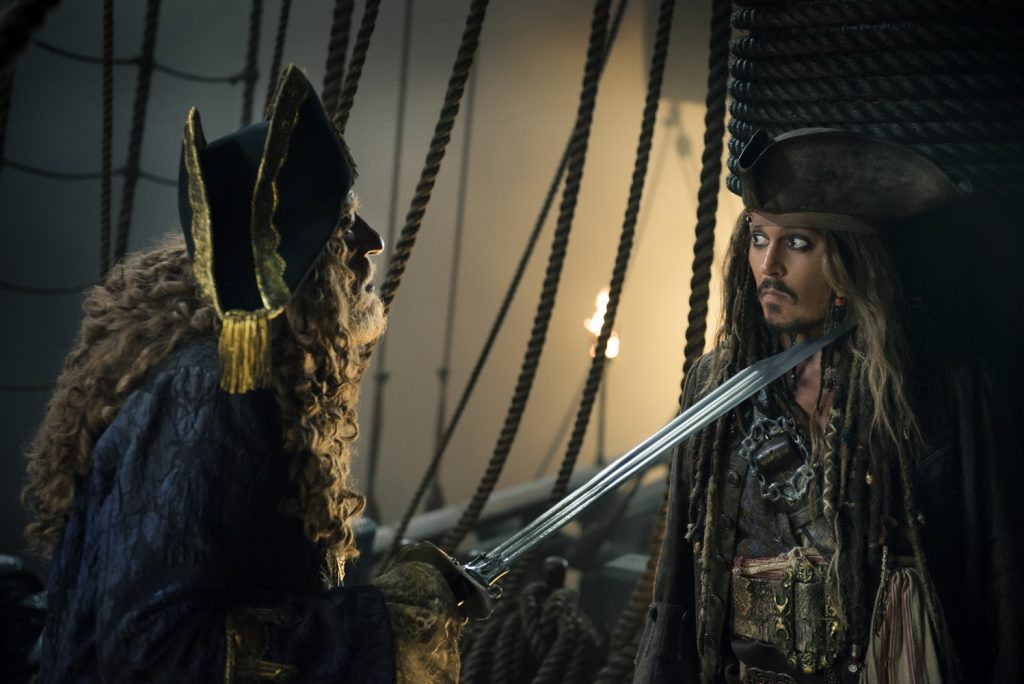"""PIRATES OF THE CARIBBEAN: DEAD MEN TELL NO TALES""..The villainous Captain Salazar (Javier Bardem) pursues Jack Sparrow (Johnny Depp) as he searches for the trident used by Poseidon..Pictured L-R: Geoffrey Rush (Barbossa) and Johnny Depp (Captain Jack Sparrow)..Ph: Peter Mountain..© Disney Enterprises, Inc. All Rights Reserved."