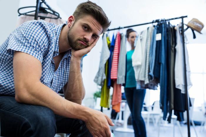 Portrait of upset man sitting in mall